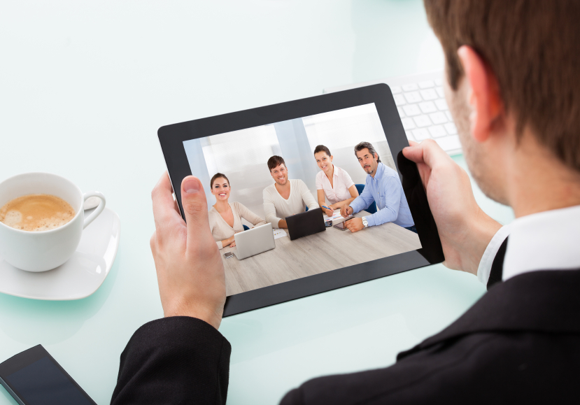 Close-up Of Businessman Looking At Video Conference On Digital Tablet