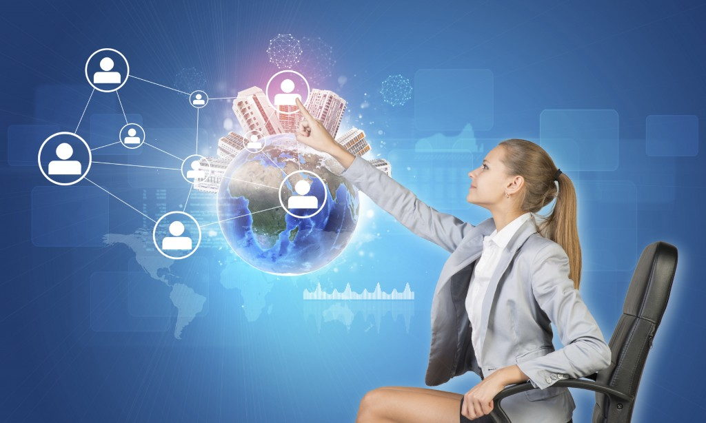 Businesswoman pressing touch screen button on virtual interface featuring Globe with buildings on top and network with person icons, on blue background. Element of this image furnished by NASA